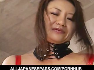slutty japanese milf in black latex with a strap