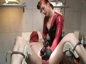 mistress into latex is torturing her slave with