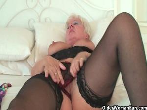 curvy elderly inside dark nylons polishes her old