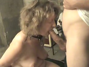 giving her master a blowjob