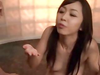 eastern lady enjoying the results of a bukkake