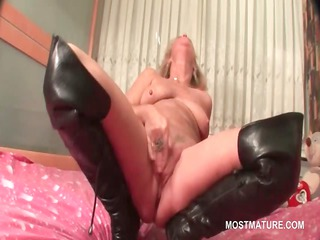 grownup in leather boots doing herself into bunk