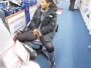 beautiful milf pisses inside the middle of a store