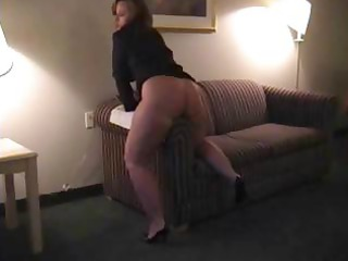 chubby brunette woman is rubbing her vagina on