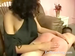 angry woman spanking boyfriend