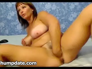 woman with large chest fisting her vagina