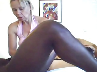 woman gives a massage and handjob to dark boy