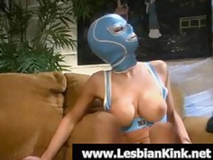 hot lesbian in rubber mask licking a giant device