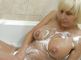 playful blonde milf with giant bosom pleases